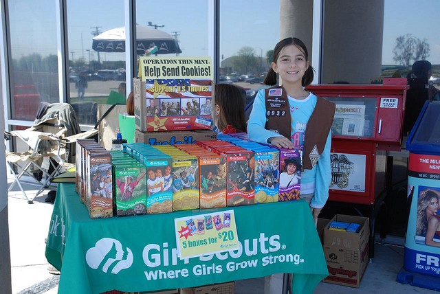A Girl Scout proudly displaying her correctly named cookies.